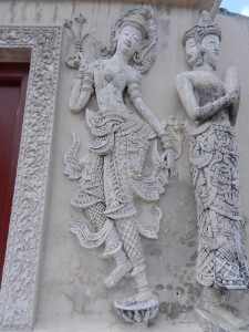 Devatas on the ho trai of Wat Phra Singh, Chiang Mai, Thailand.