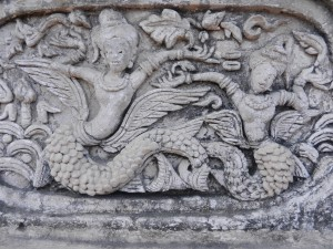 Stucco figures on the ho trai of Wat Phra Singh, Chiang Mai, Thailand.