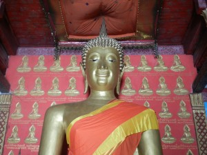 The ancient Sukhothai style Buddha at Wat Monorom, Luang Prabang, Laos.