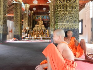 Monks in Wat That Luang, Luang Prabang, Laos.